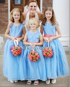 Love these flower balls!  Flower girl dresses by Pegeen.com in Melon (Dark Peach or Orange) and Blue Moon Silk Flower Girl Dresses Style 394