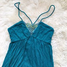 Free People Teal Tunic/Dress Teal colored tunic with embroidery front detail (can also be worn as a dress if short). Rayon. In great condition except for some pilling. Free People Dresses