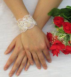 Elegant bridal lace bracelet in white and gold by NevelynkaNasha