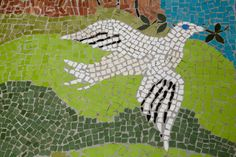 mosaic of dove flying  with olive branch in Israel