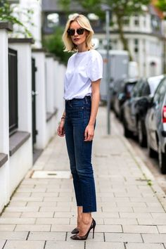 white t-shirt and cropped jeans with a bold lip