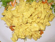 Coronation Chicken sandwich filler.  This is my favorite kind of sandwich I've tried in the UK...it's basically chicken in a mild curry sauce that is delicious!  This page has a number of variations on the basic recipe to try.  Can't wait!