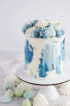 A four-inch, single tier cake with a watercolor buttercream finish. Topped with a cluster of meringues, buttercream swirls, and sprinkles.  #fathersdaycake #fathersday #celebrationcake #meringue #watercolorcake #buttercreamcake Cake Decorating Designs, Easy Cake Decorating, Birthday Cake Decorating, Cake Decorating Techniques, Watercolor Cake, Tattoo Watercolor, Watercolor Trees, Watercolor Animals, Watercolor Background