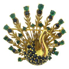 Whimsical Ostrich Multi Gem & Diamond Brooch with cabochon Columbian emeralds, Ceylon sapphires and near colorless diamonds, circa 1950s, American.