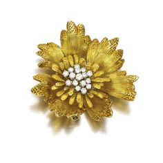 DIAMOND BROOCH, VAN CLEEF & ARPELS, 1960S, Designed as a textured flower head set to the centre with a cluster of brilliant-cut diamonds, signed Van Cleef & Arpels, made in France and numbered, French assay marks and maker's marks.