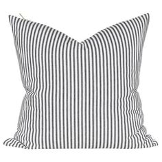 A classic, black and white ticking pillow with a beautiful brass zipper.