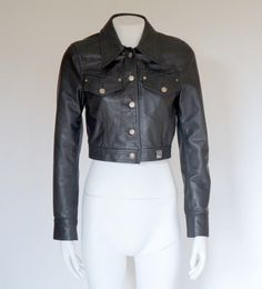 Hello Im glad youre here PANDORA FASHION  I offer vintage VERSACE JEANS COUTURE lather jacket AUTHENTIC !  color:black medusa head buttons in silver tone Made in Italy size on tag tg S 100% leather lining 100 % viscoze used in very good condition   total length 43 cm/ 16,93 inch width shoulders 36cm/14,17 inch width armpit to armpit 44 cm/ 17,32 inch length sleeves 63 cm/ 24,80 inch length sleeves from armpit 47 cm/18,50 inch   If you have any question write to me   J...