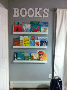Book wall in baby's room