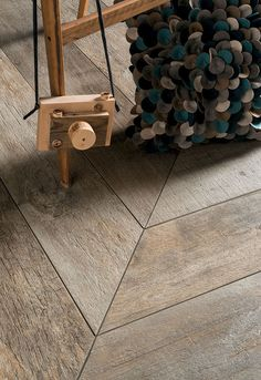 Our chevron parquet flooring helps to achieve that classic look with a modern twist! Available as a solid and engineered wood. Wood Effect Tiles, Wood Look Tile, Into The Woods, Sol Pvc Imitation Parquet, Floor Design, House Design, Parquet Chevrons, Tile Suppliers, Italian Tiles