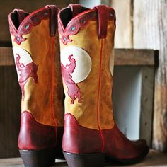 - Hand crafted - Genuine calfskin - Buckin Horse Silhouette - Snipped Toe - Retro Toe Stitch - Red Leather Piping - 2 inch heel - Leather Sole
