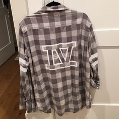 LF Flannel with detailing LF flannel with IV printed on the back and stripes on the sleeves. Worn once LF Tops Button Down Shirts
