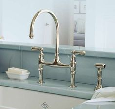 Rohl U.4719L-2 Perrin and Rowe Low Lead Bridge Kitchen Faucet with Side Spray with Metal Lever, Inca Brass by Rohl, http://www.amazon.com/dp/B003K53NM4/ref=cm_sw_r_pi_dp_.WaXrb0WFHSJR $1313