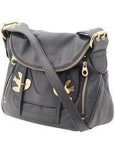 I still want this Marc Jacobs cross over bag from last year.  I didn't forget about you Petal!