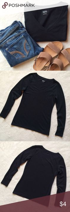 Black v-neck Mossimo Black V-Neck | Excellent staple for your closet! | Make an offer, no trades please! | Comes from a smoke-free, pet-free home!   Remember to bundle and save! First photo is not my own, posted to show how item is worn. Mossimo Supply Co Tops Tees - Long Sleeve