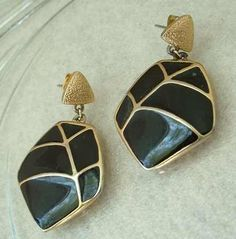 """• Main Color(s): black, gold • Materials: enamel, goldtone metal • Maker: Trifari • Approximate Year: c1975 • Size: 1.5"""" x 1"""" These lovely Trifari earring have gold wires arranged in a simple yet eleg"""