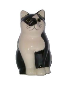 "Black and White Cat Money Box (15.5cm).  This sweetie is part of a series. Looks a bit like one of us. I think this is the Quail cat ""Smudge"" - see http://www.quailceramics.co.uk/moggies.html#"