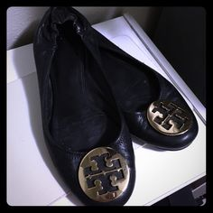 Tory burch reva flats Black with gold Tory hardware logo. Used with normal signs of wear. *one of the hardware is cracked. (See second pic)  NO HOLDS NO TRADES Tory Burch Shoes Flats & Loafers