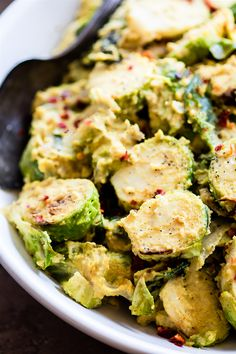 Creamy Mustard Brussels Sprouts Salad! A pan fried Brussel Sprouts superfood salad dish tossed in a vegan creamy mustard sauce. Quick to make, packed with fiber, healthy fats, and nourishment! A healthy paleo side dish to add to your table.