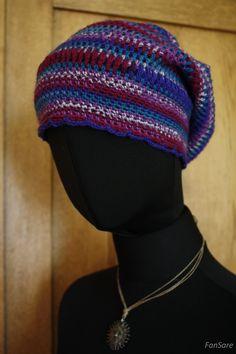 Ażurowa, kolorowa czapka dla dziewczyny z fantazją.