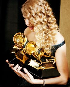 Taylor Swift won four Grammys in 2010: best female country vocal performance- white horse, best country song- white horse, best country album- fearless and album of the year- fearless