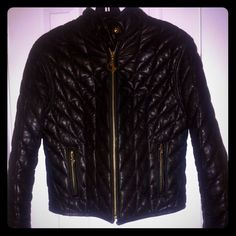BABY PHAT LEATHER PUFFER JACKET SZ.L EXCELLENT CONDITION!! IT IS A SMALL LARGE!! ITS MED. SUPER CUTE!! READY FOR YOU TO TAKE HOME!! PRICE IS FIRM!! Baby Phat Jackets & Coats Puffers