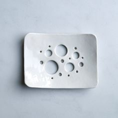 Porcelain soap dish with bubble holes and white glaze by VanillaKiln.