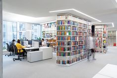 KINZO realized the book-infused office design for publishing company, Suhrkamp Verlag, located in Berlin, Germany. It was a long journey for Suhrkamp's Interior Design Magazine, Office Interior Design, Office Interiors, Berlin, Built In Furniture, Grey Table, White Shelves, Open Office, Maximize Space