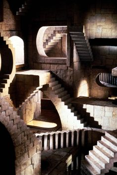 A publicity still of the Escher Room from Jim Henson's Labyrinth, an absolutely incredible set based off M.C. Escher's relativity.