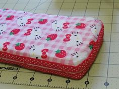 How to Make a Padded Baby Wipe Travel Case Cover Tutorial. /4 yard should be able to make you two of these.   You'll also need a hot glue gun, some quilt batting (I used Warm and Natural, which is a low pile batting) and approximately 52 inches of ribbon that is 3/8 to 5/8 inches wide.