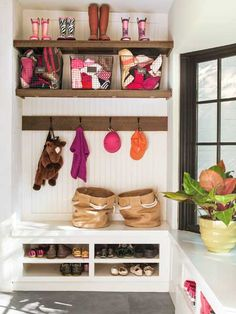 Gym baskets and shoe cubbies keep kids' wear under control in this compact corner of a back entrance mudroom.
