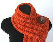 short, chunky scarf with buttons. I like this, but since I have a short neck - could never wear it!
