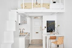 loft bed above kitchen