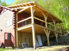 Vermont Log Cabin with Post and Beam Porch