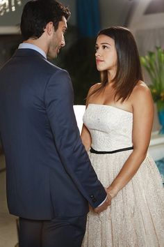 "Jane The Virgin -- ""Chapter Nine"" -- Image -- Pictured (L-R): Justin Baldoni as Rafael and Gina Rodriguez as Jane -- Photo: Greg Gayne/The CW -- © 2014 The CW Network, LLC. All rights reserved. Jane The Virgin Rafael, Jane And Rafael, Tv Show Couples, Cute Couples, Justin Baldoni, Films Netflix, Gina Rodriguez, Quinceanera Dresses, Tv Series"