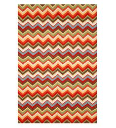 Make a bold design statement with this ZigZag-Pattern Graphic Accent Rug. Created by award-winning designer Liora Manné, this hand-crafted rug features a striking zigzag pattern in vivid shades of orange, red, green, yellow, blue, white and more.