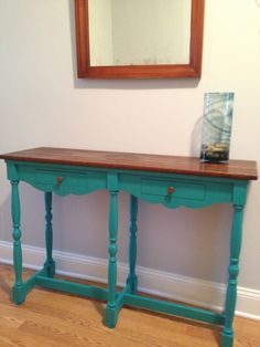 "SOLD! Intense Turquoise Table $165.00.   This vintage solid wood console table offers a stunning shot of color.  The bottom is hand painted with reclaimed brass pulls on two functioning drawers. The top is stained dark walnut and hand waxed to a smooth satin finish.    44""W x 13 1/2""D x 30""H Local pickup only from zip codes 19087 or 08505.  For more information or more pictures email info.Soldier58@gmail.com."