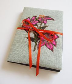 textile padded notebook with embroidered lily by NicolaJDesigns, A5 Notebook Cover, Female Friends, Old Ones, Lining Fabric, Canvas Fabric, Uni, Old Things, Lily, Gift Wrapping
