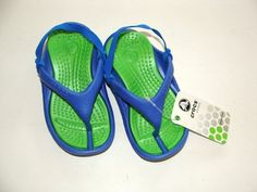 Beautiful pair of boy sandals/clogs    BRAND NEW with tags!    From: Crocs    Size: 6-7 (toddler)      Color: Blue/Green