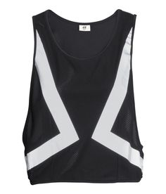 Black & white running vest in fast-drying functional fabric. Printed reflective design at front and back, with side velcro fasteners. | H&M Sport
