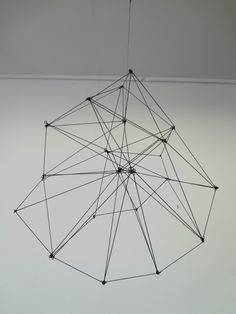 Modern geometric sculpture made from steel rods.