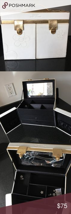 Marc Jacobs by Sephora Daisy jewelry box Limited edition gold & white Marc Jacobs for Sephora mirrored jewelry box w/black drawers & daisy emblems. Barely used & holds tons of jewelry! The top level opens to a mirrored top & four divided compartments; the middle drawer slides w/a medium compartment & small section; the bottom drawer is one large undivided compartment. The front swings out to expose left & right pockets, perfect for bracelets! *please note the minor scratches on the edges by…