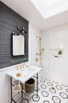 Alyssa Rosenheck - Taylor Anne Interiors - Black grasscloth wallpaper in a bathroom over bottom half white subway and chair rail tiles.
