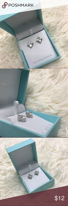 NEW Princess-cut CZ earrings in Sterling Silver New in box, sweet CZ stone studs in sterling silver setting. Little stones surround the solitaire. Contessa by Capri Jewelry Earrings