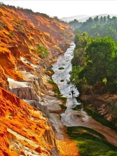 This is not a painting. Locates 20km northeast of Phan Thiet City center, Mui Ne Fairy Stream looks like a soft border between a dessert and its oasis - with red sand rocky ledges on one bank and flat land forest occupied the other. During the dry season when the water level is low enough, lots of visitors will stop by for a fantastic experience of letting the cool stream water rush by their feet while enjoying a short walk upstream! Beautiful Vietnam, Mui Ne, First Bank, Ho Chi Minh City, Phan, Tour Guide, Oasis, Fairy, Tours