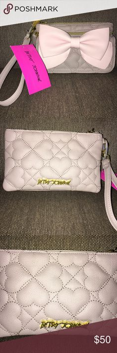 NWT Betsey Johnson gray and pink wristlet New Betsey Johnson wristlet in a gray quilted heart design with pink bow. Front of purse opens to a wallet with button closure. Main compartment has a zip closure. There is a smaller zip compartment below the main compartment. This listing is for the gray and pink wristlet only. The last picture shows other colors and designs that I also have for sale. Please see those individual listings for details. Betsey Johnson Bags Clutches & Wristlets