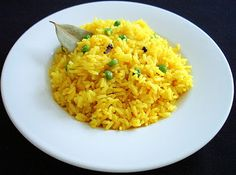 "Saffron Pulao: 2 cups long grain rice, 1 cup Greenpeas, 1/2 tbsp butter, 4 cloves,  1 bay Leaf, few peppercorns,  1/2"" Cinnamon, 1 crushed Cardamom,  1/8 tsp salt,  3.5 cups water,  1 tsp Lemon juice,  1/4 tsp Saffron strands or 1/8 tsp Saffron powder"