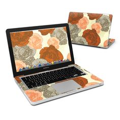 """DecalGirl Apple MacBook Pro 13"""" skins feature vibrant full-color artwork that helps protect the Apple MacBook Pro 13"""" from minor scratches and abuse without adding any bulk or interfering with the device's operation.   This skin features the artwork Roses by Valentina Ramos - just one of hundreds of designs by dozens of talented artists from around the world."""