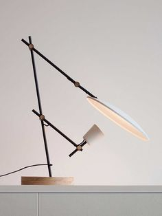 Crescent Table Lamp by Lewis Yee features adjustable arms and a rotating diffuse reflector dish. Suitable for task and ambient lighting.