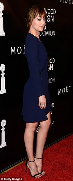 Simply chic: Dakota Johnson opted for understated elegance in a midnight blue dress