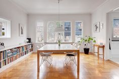 I love the long sideboard, lots of storage space, room looks wide, my scandinavian home: A lovely white and grey Stockholm home